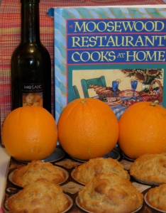 photo shows Mosaic blood orange oil, cookbook, oranges and muffins