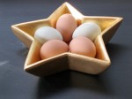 Original photo of brown and blue eggs in gold star dish. Photo by Sharyn Dimmick.
