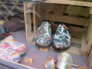 Photo shows window display of hand-painted shoes in the Marais.
